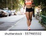 runner listening to music while ... | Shutterstock . vector #557985532