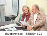 senior couple calculating taxes ... | Shutterstock . vector #558004822