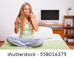 young woman is sitting in bed... | Shutterstock . vector #558016375