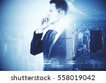 businessman with phone on city... | Shutterstock . vector #558019042