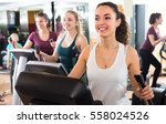 group of cheerful smiling women ... | Shutterstock . vector #558024526