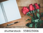 Stock photo red roses leather notebook pen and cup of coffee on wooden background with copy space valentines 558025006