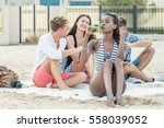 cheerful young woman drinking... | Shutterstock . vector #558039052