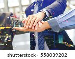 hand group teamwork join hands... | Shutterstock . vector #558039202