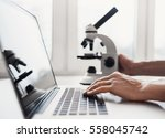 scientist or student using ... | Shutterstock . vector #558045742