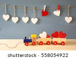 wooden toy train with hearts on ... | Shutterstock . vector #558054922