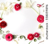 Stock photo floral frame of pink and red roses or ranunculus white tulips and green leaves on white background 558059896