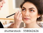 make up artist doing make up... | Shutterstock . vector #558062626
