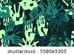seamless pattern of  handprints.... | Shutterstock .eps vector #558065305