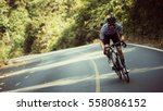 asian men are cycling road bike ... | Shutterstock . vector #558086152