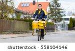 Postman Riding His Cargo Bike...