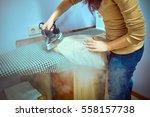 closeup of woman ironing... | Shutterstock . vector #558157738