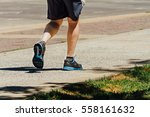 Man Walks Exercising In A Park