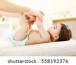 mother and her baby girl... | Shutterstock . vector #558192376