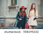two pretty girls walking in the ... | Shutterstock . vector #558195232