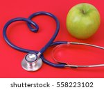 green apple and stethoscope... | Shutterstock . vector #558223102