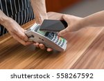 customer is paying with... | Shutterstock . vector #558267592