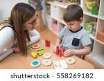 mother and son spending time... | Shutterstock . vector #558269182