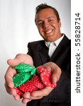 A man holding up green and red poker chips - stock photo