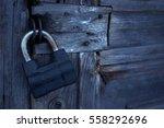 Iron Lock On An Old Wooden Door.