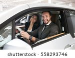 attractive couple chooses a new ... | Shutterstock . vector #558293746