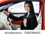 pretty girl sitting in a car... | Shutterstock . vector #558296692