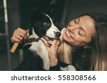 young pretty woman hugging her... | Shutterstock . vector #558308566