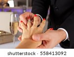 close up of man putting ring to ...   Shutterstock . vector #558413092