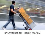 delivery goods with dolly by... | Shutterstock . vector #558470782