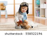 happy kid playing with wooden... | Shutterstock . vector #558522196