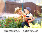 happy mother and child watering ... | Shutterstock . vector #558522262