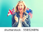 young woman with flags of... | Shutterstock . vector #558524896