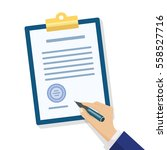 male hand signing document....   Shutterstock .eps vector #558527716