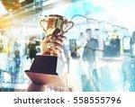 win concept man holding up a... | Shutterstock . vector #558555796