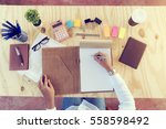 co workers work space on wood... | Shutterstock . vector #558598492