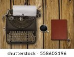 vintage typewriter and coffee... | Shutterstock . vector #558603196