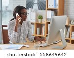 Small photo of African-American female entrepreneur talking on the phone