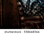 usa flag on a wood surface | Shutterstock . vector #558668566