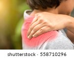 woman with shoulder pain | Shutterstock . vector #558710296