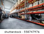 Warehouse industrial goods. Large long racks. Cardboard boxes and coiled plastic tube. Toning the image.