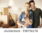 Stock photo portrait of couple with small pet 558756178