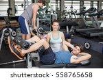 trainer woman helping man doing ... | Shutterstock . vector #558765658
