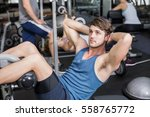 handsome man working his abs in ... | Shutterstock . vector #558765772