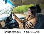 woman driving car | Shutterstock . vector #558780646