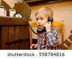 the boy sits on a chair in a... | Shutterstock . vector #558784816