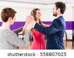 instructor in dance school with ... | Shutterstock . vector #558807025