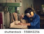asian young carpenter using... | Shutterstock . vector #558843256