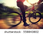 young woman riding mountain... | Shutterstock . vector #558843802