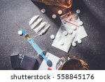 hard drugs and alcohol on dark... | Shutterstock . vector #558845176