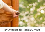 women hand open door knob or... | Shutterstock . vector #558907405